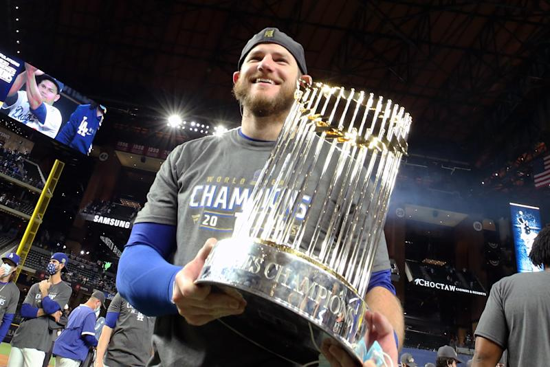 ARLINGTON, TX - OCTOBER 27: Max Muncy #13 of the Los Angeles Dodgers poses for a photo with the World Series trophy after the Los Angeles Dodgers win Game 6 of the 2020 World Series 3-1 against the Tampa Bay Rays to win the championship at Globe Life Field on Tuesday, October 27, 2020 in Arlington, Texas. (Photo by Kelly Gavin/MLB Photos via Getty Images)