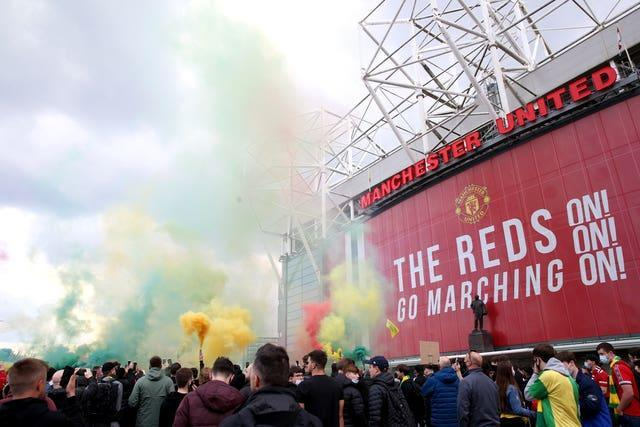 Fans let off flares as they protest against the Glazer family, owners of Manchester United
