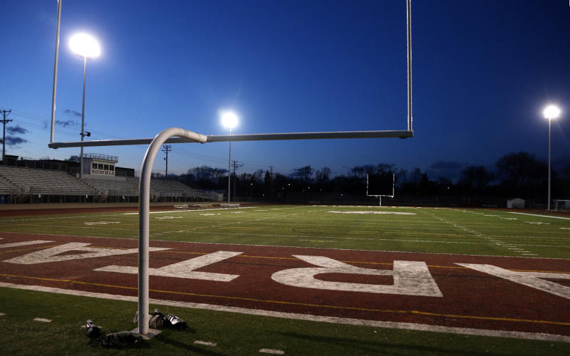 The lights shine on an empty football stadium at Richfield High School Wednesday night, April 8, 2020, in Richfield, Minn. Seeking to brighten spirits amid the virus outbreak, the symbolic act of turning on the lights became a movement fueled by social media with the hashtag #BeTheLight across the country. (AP Photo/Jim Mone)