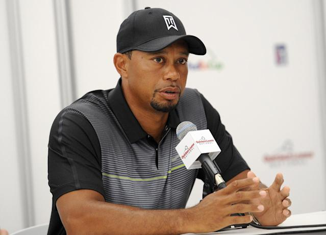 Tiger Woods speaks at a press conference at the Quicken Loans National golf tournament, Tuesday, June 24, 2014, in Bethesda, Md. (AP Photo/Nick Wass)