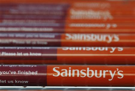 Shopping trolleys are seen parked at a Sainsbury's supermarket at Pulborough, southern England January 8, 2014. REUTERS/Luke MacGregor