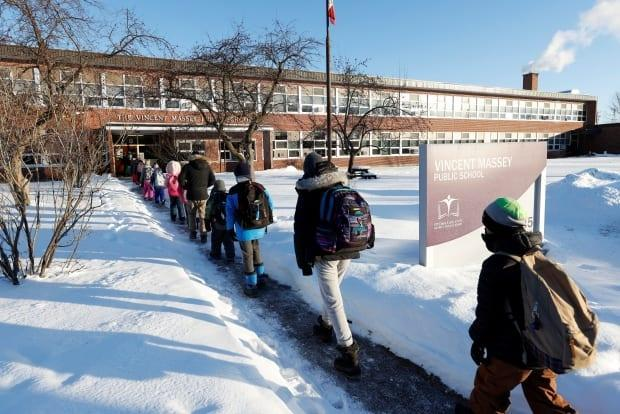 Students return to in-class learning at Vincent Massey Public School in February. Parents with Ottawa's English public board have until midnight tonight to decide whether their students will head back to the classroom for next year — or will continue to learn remotely. (Blair Gable/Reuters - image credit)