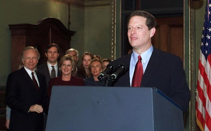 Vice president Al Gore stands at the podium, after conceding the presidential election, Wednesday, December 13, 2000.