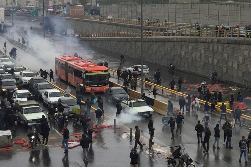 People protest against increased gas price, on a highway in Tehran