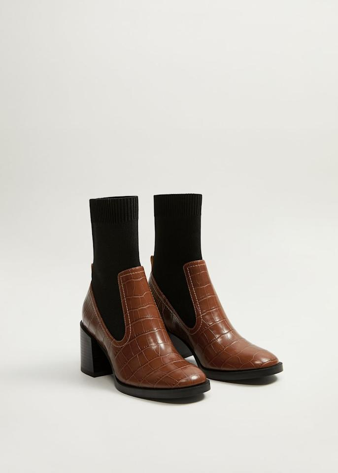 """<p><a href=""""https://www.popsugar.com/buy/Mango-Stretched-Contrast-Ankle-Boots-489014?p_name=Mango%20Stretched%20Contrast%20Ankle%20Boots&retailer=shop.mango.com&pid=489014&price=100&evar1=fab%3Aus&evar9=46565054&evar98=https%3A%2F%2Fwww.popsugar.com%2Ffashion%2Fphoto-gallery%2F46565054%2Fimage%2F46595842%2FMango-Stretched-Contrast-Ankle-Boots&list1=fall%20fashion%2Cshoes%2Cboots%2Ctrends%2Cfall&prop13=mobile&pdata=1"""" rel=""""nofollow"""" data-shoppable-link=""""1"""" target=""""_blank"""" class=""""ga-track"""" data-ga-category=""""Related"""" data-ga-label=""""https://shop.mango.com/us/women/shoes-boots-and-booties/stretched-contrast-ankle-boots_53075776.html"""" data-ga-action=""""In-Line Links"""">Mango Stretched Contrast Ankle Boots</a> ($100)</p>"""