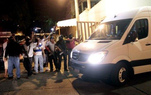 Statal police escort a van with twelve Spanish citizens and a Mexican woman leaving the Office of Justice of Guerrero State in Acapulco on February 4, 2013. Acapulco's mayor Luis Walton confirmed that six Spanish women, part of a group of 13 tourists, were raped by a band of criminals near the touristic port of Acapulco. AFP PHOTO/ Pedro PARDO (AFP | Pedro Pardo)
