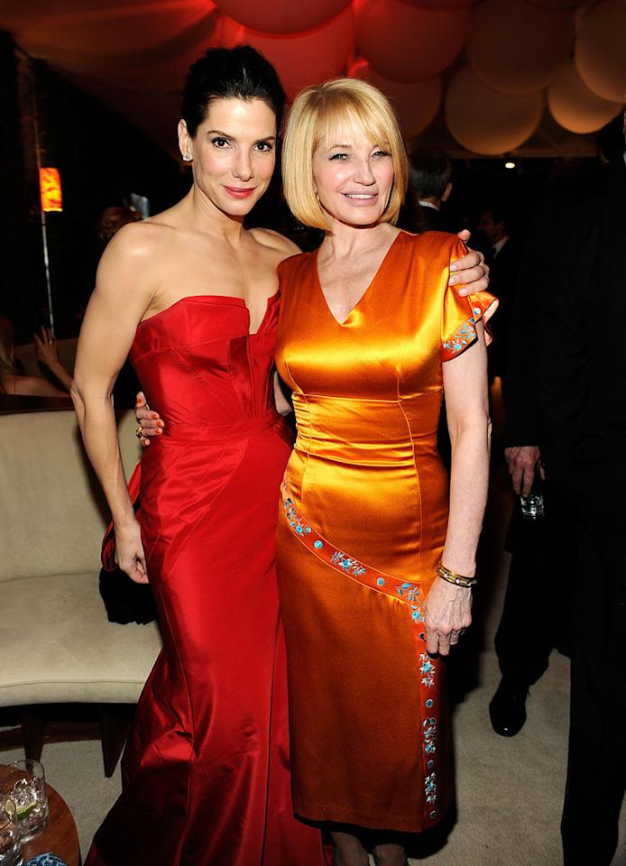 Last year's Best Actress winner Sandra Bullock (in Vera Wang) hugged it out with her big screen buddy Ellen Barkin, who looked stunning in a tangerine dream, at the VF shindig.