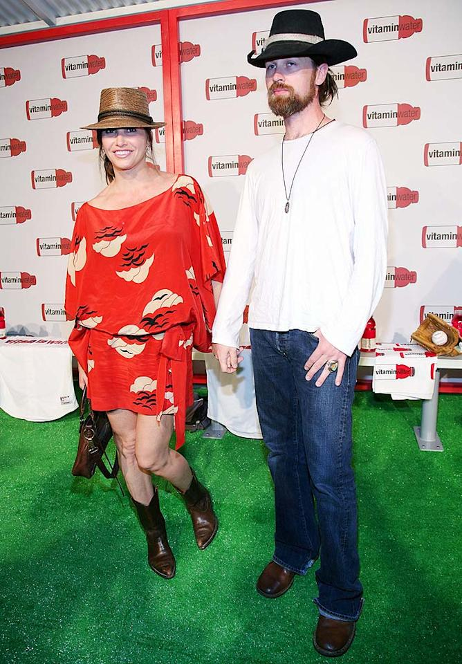 "Gina Gershon keeps cool in a loose frock, while her bearded beau swelters in a long-sleeved shirt and jeans. Astrid Stawiarz/<a href=""http://www.gettyimages.com/"" target=""new"">GettyImages.com</a> - July 14, 2008"