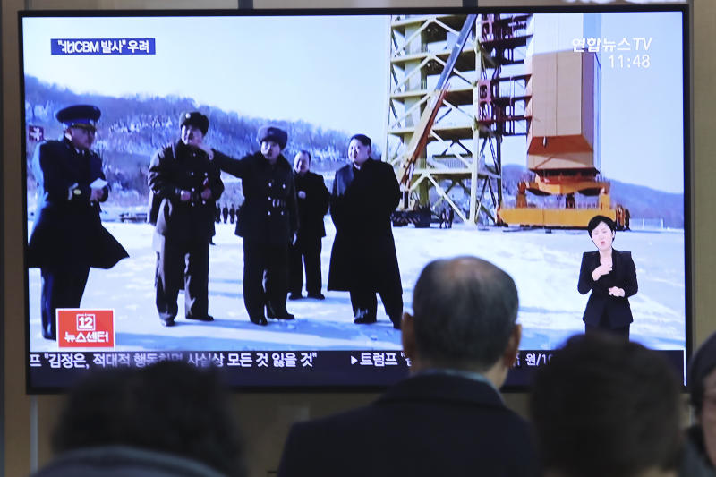 """A man watches a TV screen showing a file image of the North Korean leader Kim Jong Un at his county long-range rocket launch site during a news program at the Seoul Railway Station in Seoul, South Korea, Monday, Dec. 9, 2019. North Korea said Sunday it carried out a """"very important test"""" at its long-range rocket launch site that it reportedly rebuilt after having partially dismantled it after entering denuclearization talks with the United States last year.(AP Photo/Ahn Young-joon)"""