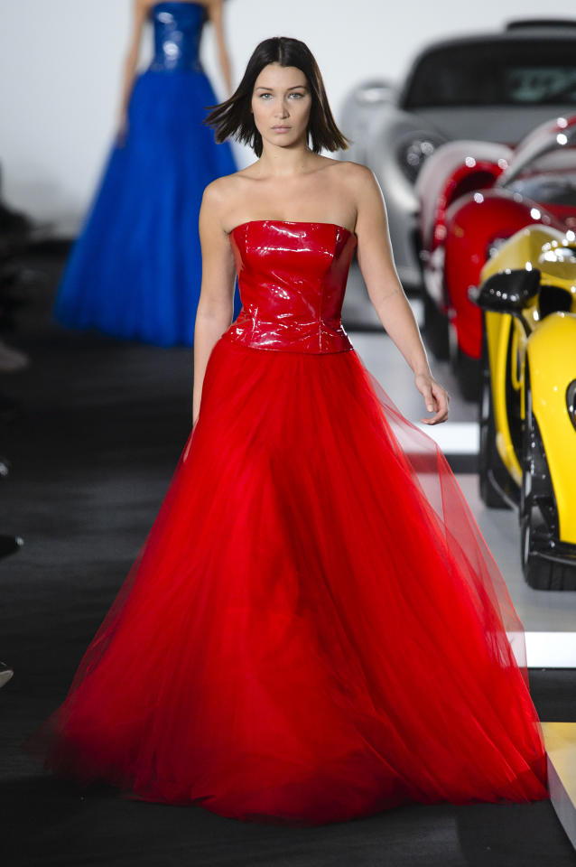 <p>Model Bella Hadid wears a strapless, bright crimson ball gown from the SS18 Ralph Lauren collection. (Photo: ImaxTree) </p>