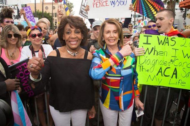 Rep. Maxine Waters, D-Calif., left, and House Minority Leader Nancy Pelosi attend the L.A. Pride Resist March on June 11. (Photo: Gabriel Olsen/FilmMagic/Getty Images)