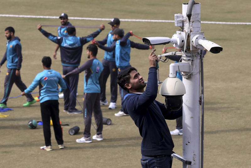 A worker installs security cameras at Gaddafi stadium as preparation for the upcoming series against Bangladesh in Lahore, Pakistan, Tuesday, Jan. 21, 2020. Pakistan will play three Twenty20 series against Bangladesh, starting from Jan. 24, at Lahore. (AP Photo/K.M. Chaudary)
