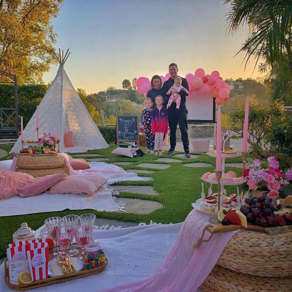 """<p>""""Last night we had the most magical celebration for Kenzie's birthday!"""" the <em>7th Heaven</em> alum wrote of this <a href=""""https://www.instagram.com/p/CM8CfXnssMi/"""" rel=""""nofollow noopener"""" target=""""_blank"""" data-ylk=""""slk:backyard bash"""" class=""""link rapid-noclick-resp"""">backyard bash</a> for her oldest daughter's eighth birthday — complete with a screening of Disney's <em>Raya and The Last Dragon.</em> """"A truly magical birthday indeed!"""" she added.</p>"""