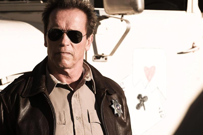 """This undated publicity photo released by Lionsgate shows Arnold Schwarzenegger as Ray Owens, in a scene from the film, """"The Last Stand."""" (AP Photo/Lionsgate, Merrick Morton)"""