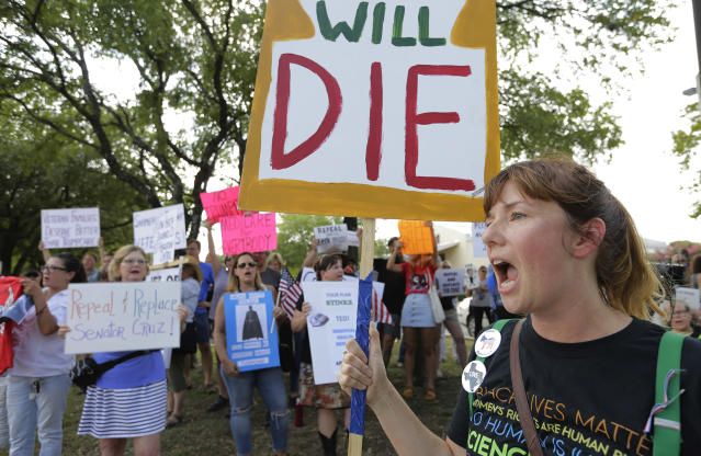 <p>Protesters gather outside a Sen. Ted Cruz town hall meeting, Thursday, July 6, 2017, in Austin, Texas. Cruz is expressing doubt about whether the Republican plan to repeal and replace former President Barack Obama's health care law will pass the Senate, suggesting Thursday that efforts to cobble together enough votes are on shaky ground. Protesters were defending the Obama administration's health law and waving anti-Cruz signs. (Photo: Eric Gay/AP) </p>