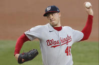 Washington Nationals starting pitcher Patrick Corbin (46) winds up during the first inning of a baseball game against the New York Mets, Monday, Aug. 10, 2020, in New York. (AP Photo/Kathy Willens)