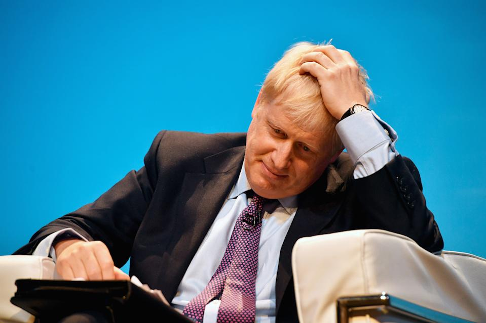 Boris Johnson refused to answer questions at Saturday's hustings in Birmingham about a police visit to his home (Picture: PA)