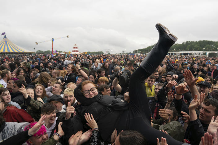 A festivalgoer crowd surfs on the first day of Download Festival at Donington Park at Castle Donington, England, Friday June 18, 2021. The three-day music and arts festival is being held as a test event to examine how Covid-19 transmission takes place in crowds, with the the capacity significantly reduced from the normal numbers. (Joe Giddens/( /PA via AP)