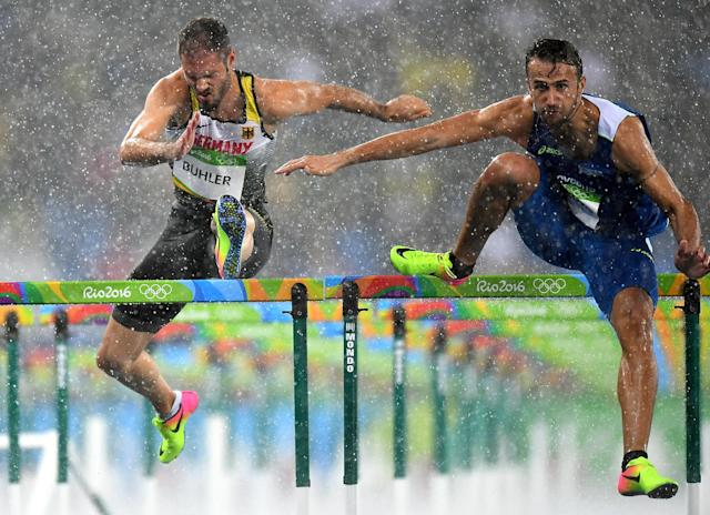 <p>Rain doesn't stop this show. Track athletes competed during rainstorms in Brazil and coincidently enough, several athletes were disqualified because of error. Blame it on the rain? (Photo by Quinn Rooney/Getty Images) </p>
