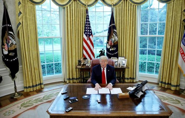 FILE PHOTO: U.S. President Trump answers questions during an interview with Reuters in the Oval Office of the White House in Washington