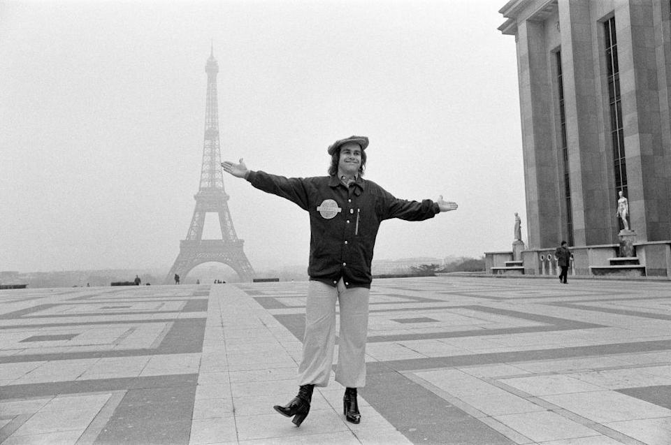 <p>The Rocket Man himself poses in front of the Eiffel Tower in February 1979. Later that year, the musician released his 13th studio album, <em>Victim of Love</em>.</p>