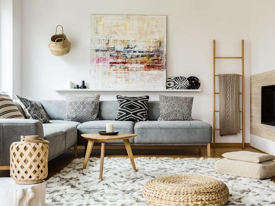 Neutral-toned living room with funky pillows and large canvas.