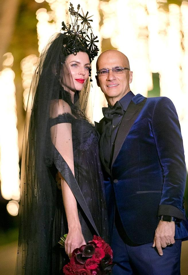 """<p>It looks like Liberty Ross has officially put that whole <a href=""""http://www.vanityfair.com/style/2013/12/liberty-ross-rupert-sanders-kristen-stewart"""">Kristen Stewart scandal</a> behind her! On Valentine's Day, the model and actress, 37, married music mogulJimmy Iovine, 62, in Los Angeles. The fashion lover's dress was the complete opposite of typical: Instead of going with a white or champagne colored look, Ross wore a vintage Givenchy gown in black and navy. But thepièce de résistance was her dramatic veil and headpiece, custom-created by London-based milliner Stephen Jones. Ross's new husband sported a blue velvet tux by Tom Ford, and all the couple's guests were asked to wear red — matching the bride'scalla lily and rose bouquet and lipstick perfectly. <i>(Photo:The Iovine Family)</i></p>"""
