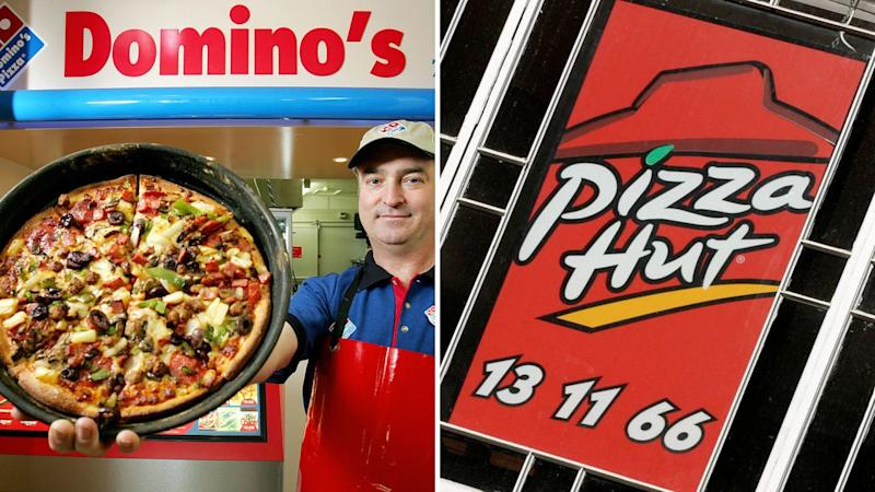 A Domino's worker holding up a pizza on the left, a Pizza Hut sign on the right.