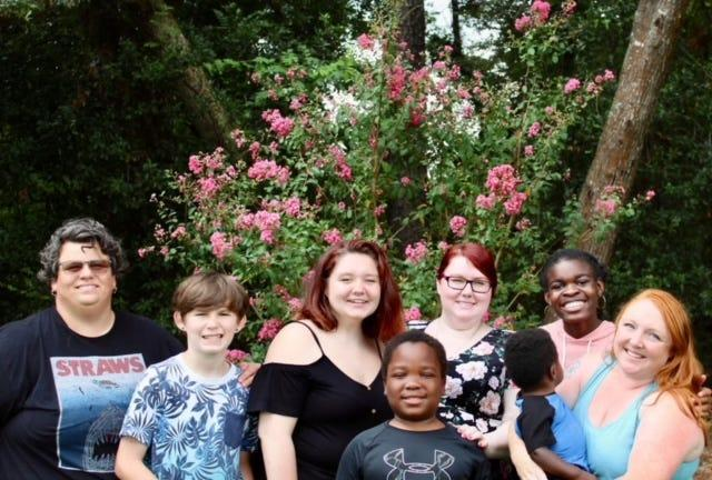 Amanda Cruce, right, with her wife Deena Cruce, left, and their children.