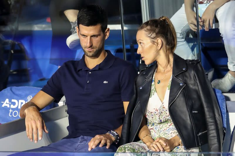 FILE PHOTO: Serbia's Novak Djokovic with his wife Jelena in the stands during Adria Tour at Novak Tennis Centre in Belgrade