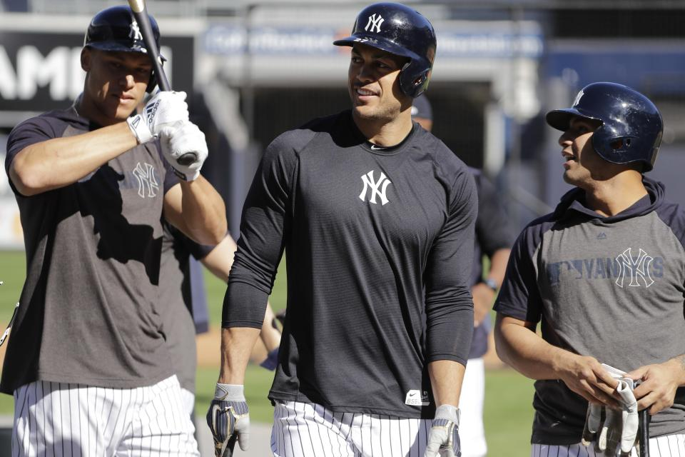 New York Yankees' Giancarlo Stanton, center, and Aaron Judge, left, walks with teammates during a practice at Yankee Stadium Thursday, Oct. 10, 2019, New York. The Yankees will play the winner of tonight's Tampa Bay Rays at Houston Astros American League Division Series game in Game 1 of the American League Championship Series on Saturday, Oct. 12 in New York. (AP Photo/Frank Franklin II)