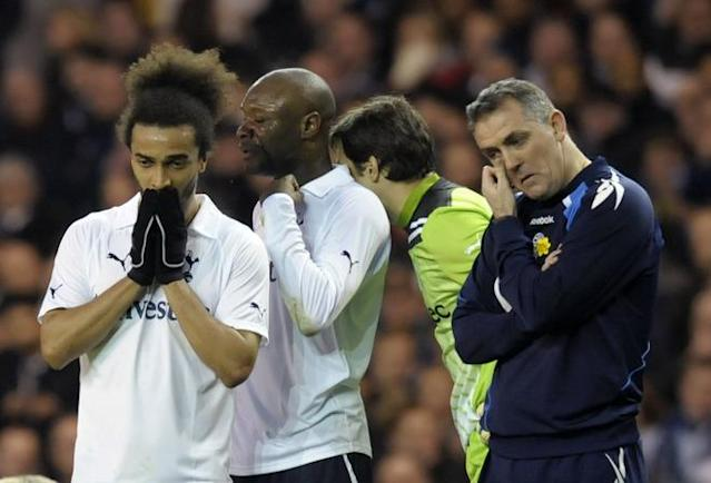 "Bolton Wanderer's manager Owen Coyle (R) stands beside Tottenham players, Benoit Assou-Ekotto (L), William Gallas (2nd L) and Carlo Cudicini (2nd R) as Bolton's English midfielder Fabrice Muamba (not pictured) is treated by medical staff after collapsing during the English FA Cup quarter-final football match between Tottenham Hotspur and Bolton Wanderers at White Hart Lane in north London, England on March 17, 2012. The game was abandoned at half-time as Muamba was taken to hospital. RESTRICTED TO EDITORIAL USE. No use with unauthorized audio, video, data, fixture lists, club/league logos or ""live"" services. Online in-match use limited to 45 images, no video emulation. No use in betting, games or single club/league/player publications (Photo by Olly Greenwood/AFP/Getty Images)"