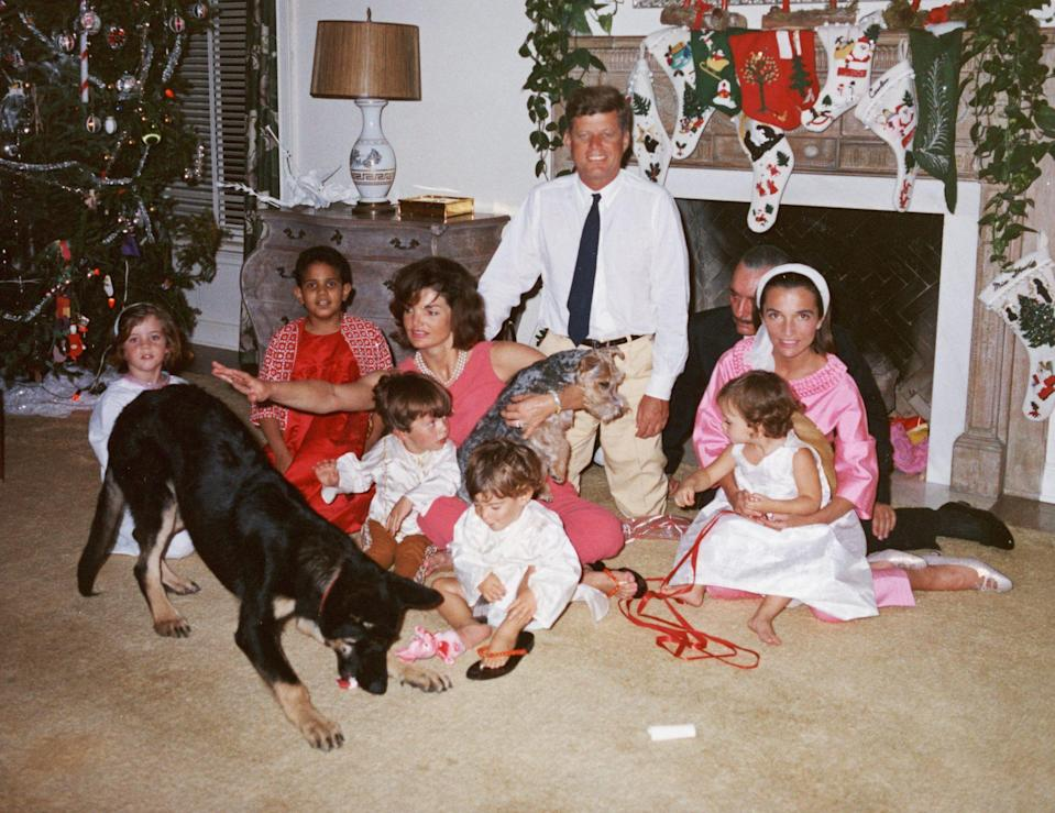<p>President John F. Kennedy and First Lady Jacqueline gather with their young family, including Caroline, John Jr., Anthony Radziwill, Prince Stanislaus Radziwill, Lee Radziwill and Ann Christine Radziwill, and a few of their pets on Christmas Day, 1962.</p>