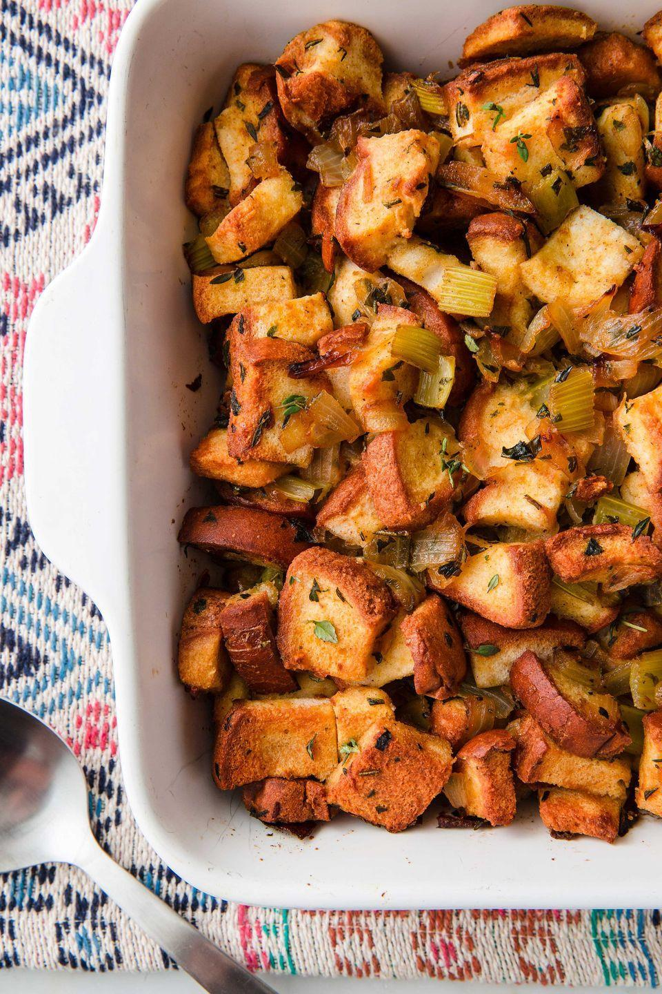 """<p>Add some sausage if ya want!</p><p>Get the recipe from <a href=""""https://www.delish.com/cooking/recipe-ideas/a22566155/best-gluten-free-stuffing-recipe/"""" rel=""""nofollow noopener"""" target=""""_blank"""" data-ylk=""""slk:Delish"""" class=""""link rapid-noclick-resp"""">Delish</a>. </p>"""