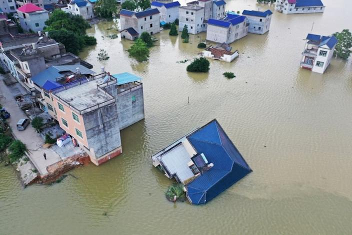 China blasts dam to release floodwaters as death toll rises