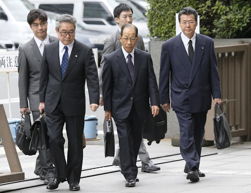 Olympus Corp.'s former President Tsuyoshi Kikukawa, front center, arrives with his lawyers at Tokyo District Court in Tokyo Tuesday, Sept. 25, 2012.  Kikukawa admitted guilt Tuesday in a cover-up scandal of massive investment losses at the major Japanese camera and medical equipment company. (AP Photo/Kyodo News) JAPAN OUT, MANDATORY CREDIT, NO LICENSING IN CHINA, FRANCE, HONG KONG, JAPAN AND SOUTH KOREA