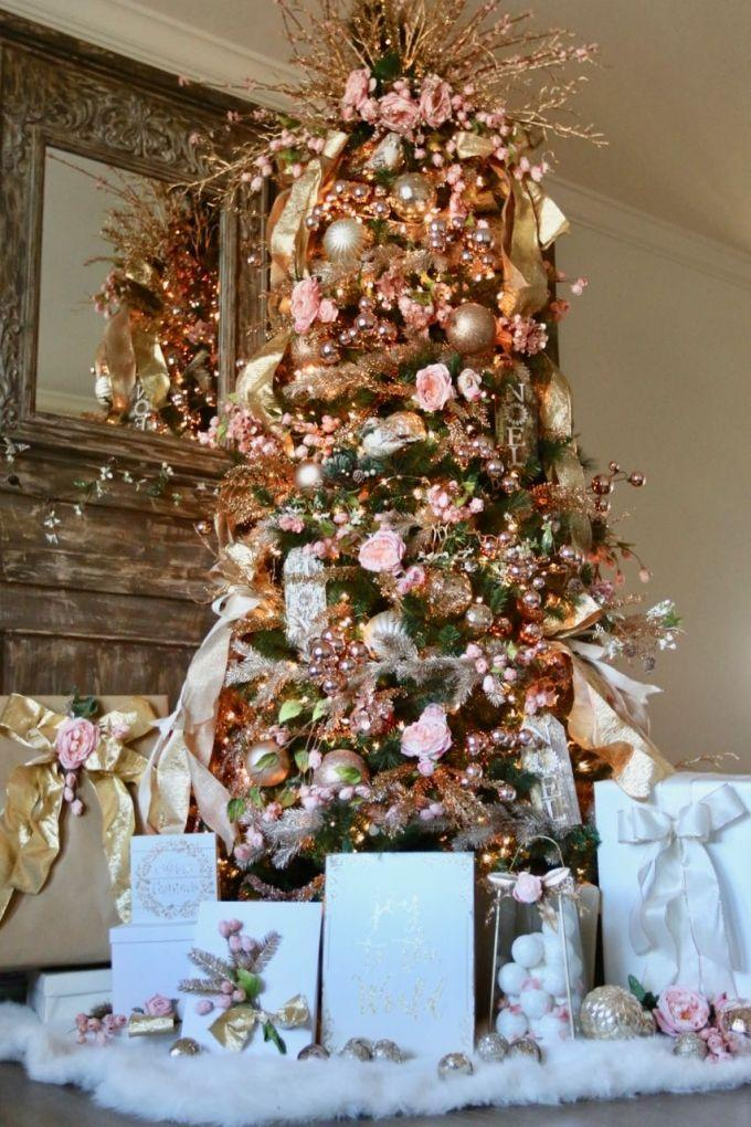 """<p>You may not associated florals and metallics with Christmastime, but adding them to a Christmas tree certainly spruces things up.</p><p><strong><em>Get the tutorial at <a href=""""https://www.designdazzle.com/pink-florals-and-gold-metallics-christmas-tree/"""" rel=""""nofollow noopener"""" target=""""_blank"""" data-ylk=""""slk:Design Dazzle"""" class=""""link rapid-noclick-resp"""">Design Dazzle</a>. </em></strong></p><p><a class=""""link rapid-noclick-resp"""" href=""""https://www.amazon.com/KI-Store-Shatterproof-Decorations-Decoration/dp/B07FX4FGHX?tag=syn-yahoo-20&ascsubtag=%5Bartid%7C10070.g.2025%5Bsrc%7Cyahoo-us"""" rel=""""nofollow noopener"""" target=""""_blank"""" data-ylk=""""slk:SHOP ROSE GOLD ORNAMENTS"""">SHOP ROSE GOLD ORNAMENTS</a></p>"""