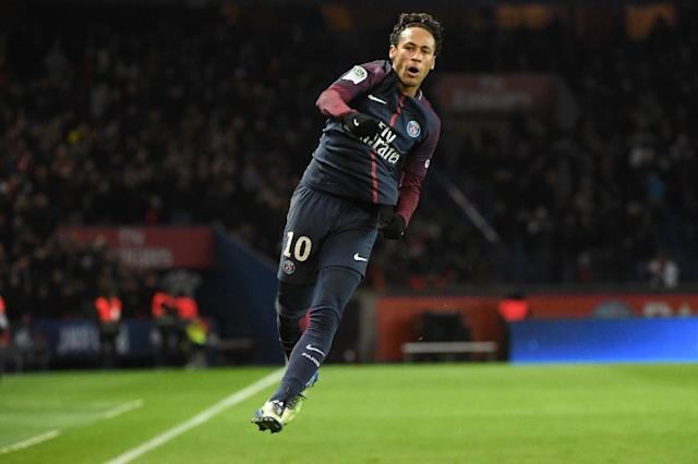 Paris Saint-Germain's Brazilian forward Neymar celebrates after scoring a goal against Dijon on January 17, 2018 at the Parc des Princes stadium in Paris (AFP Photo/CHRISTOPHE ARCHAMBAULT )