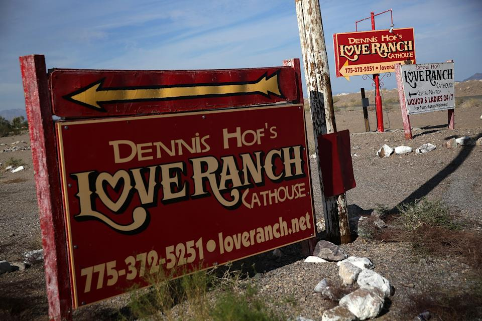 CRYSTAL, NV - OCTOBER 14:  Signs for Dennis Hof's Love Ranch Las Vegas brothel are shown on October 14, 2015 in Crystal, Nevada. Former NBA player Lamar Odom was found unconscious during a visit at the brothel and has been hospitalized at Sunrise Hospital & Medical Center in Las Vegas.  (Photo by Alex Wong/Getty Images)