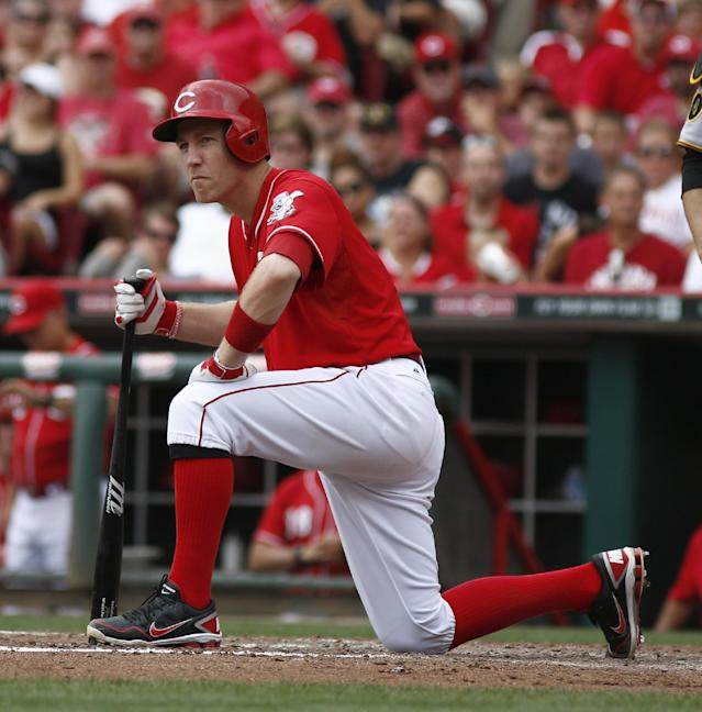 Cincinnati Reds' Todd Frazier kneels at home plate after striking out with the bases loaded in the fourth inning of a baseball game against the Pittsburgh Pirates, Sunday, July 13, 2014, in Cincinnati. (AP Photo/David Kohl)