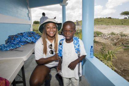 Tia Avril with one of the young students who will attend the new school (Avril Family Foundation)