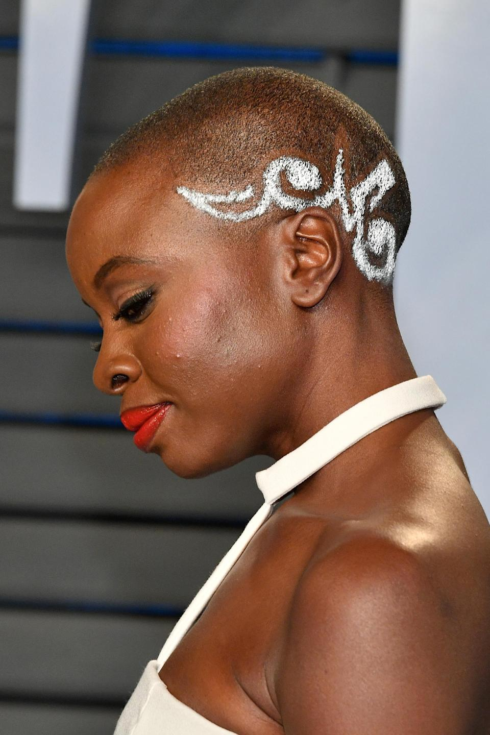 Danai Gurira attended the 2018 Vanity Fair Oscar Party in Beverly Hills, Calif., sporting a buzzcut with an intricate design. (Photo: Getty Images)