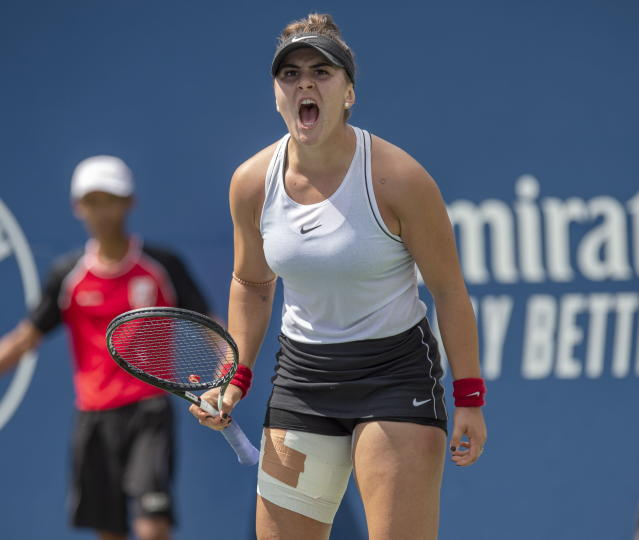 Bianca Andreescu, of Canada, celebrates a point on her way to defeating Sofia Kenin, of the United States during the Rogers Cup womens tennis tournament Saturday, Aug. 10, 2019, in Toronto. (Frank Gunn/The Canadian Press via AP)