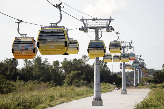 Gondolas move to various locations at Walt Disney World on the Disney Skyliner aerial tram, Friday, Sept. 27, 2019, in Lake Buena Vista, Fla. The Disney Skyliner gondolas opening to visitors on Sunday are the latest addition to one of the largest private transportation systems in the U.S.(AP Photo/John Raoux)