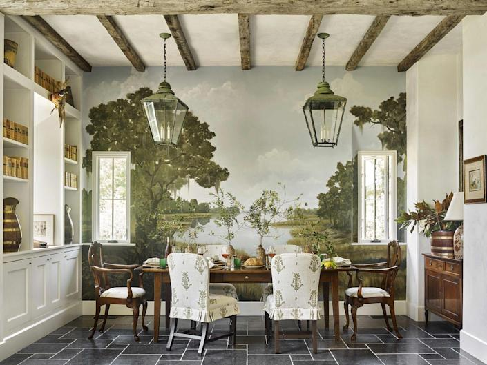 """<p>The ultimate showstopper, a hand-painted mural, transports guests to landscapes far and wide through the carefully detailed work of decorative painters. Designer <a href=""""https://bethwebb.com/"""" rel=""""nofollow noopener"""" target=""""_blank"""" data-ylk=""""slk:Beth Webb"""" class=""""link rapid-noclick-resp"""">Beth Webb</a> called upon Savannah-based artist <a href=""""https://www.bobchristiandecorativeart.com/"""" rel=""""nofollow noopener"""" target=""""_blank"""" data-ylk=""""slk:Bob Christian"""" class=""""link rapid-noclick-resp"""">Bob Christian </a>to paint a serene mural in this <a href=""""https://www.veranda.com/decorating-ideas/house-tours/a33487574/beth-webb-brays-island-house-tour/"""" rel=""""nofollow noopener"""" target=""""_blank"""" data-ylk=""""slk:cozy cottage"""" class=""""link rapid-noclick-resp"""">cozy cottage</a> that pays homage to its Low Country setting. The lanterns and table are both from <a href=""""https://www.englishaccentantiques.com/"""" rel=""""nofollow noopener"""" target=""""_blank"""" data-ylk=""""slk:English Accent Antiques"""" class=""""link rapid-noclick-resp"""">English Accent Antiques</a>.</p>"""