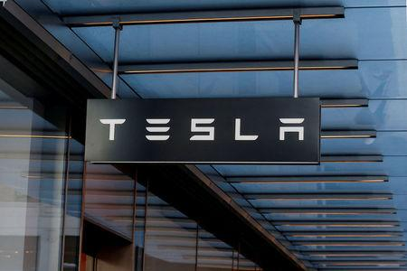 FILE PHOTO:  A sign is seen outside Tesla Motors' new showroom in Manhattan's Meatpacking District in New York City