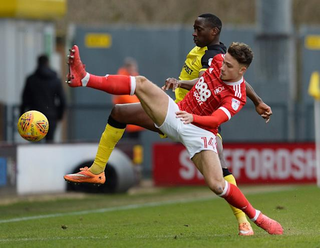 "Soccer Football - Championship - Burton Albion vs Nottingham Forest - Pirelli Stadium, Burton-on-Trent, Britain - February 17, 2018 Nottingham Forest's Matthew Cash in action with Burton's Lucas Akins Action Images/Alan Walter EDITORIAL USE ONLY. No use with unauthorized audio, video, data, fixture lists, club/league logos or ""live"" services. Online in-match use limited to 75 images, no video emulation. No use in betting, games or single club/league/player publications. Please contact your account representative for further details."