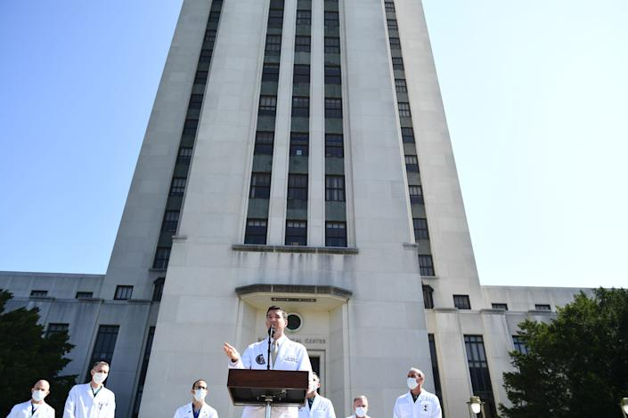 Sean Conley answers questions outside in front of Walter Reed hospital