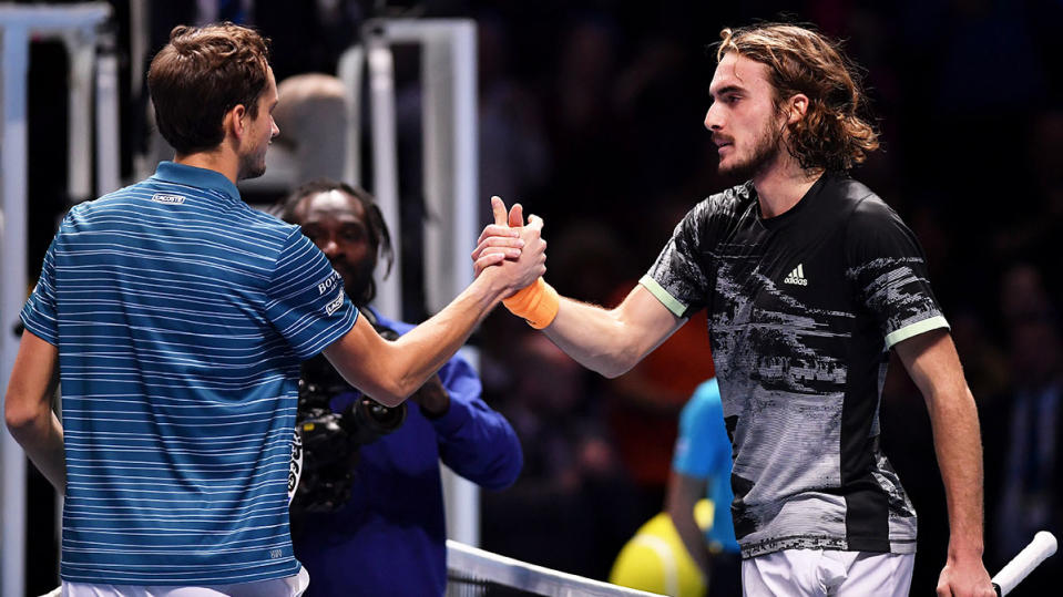 Daniil Medvedev of Russia shakes hands at the net with Stefanos Tsitsipas of Greece after their singles match during Day Two of the Nitto ATP World Tour Finals at The O2 Arena on November 11, 2019 in London, England. (Photo by Justin Setterfield/Getty Images)