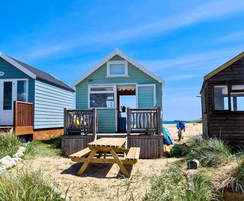 Britain's most expensive ever beach hut has gone on the market for a whopping £575K. (SWNS)